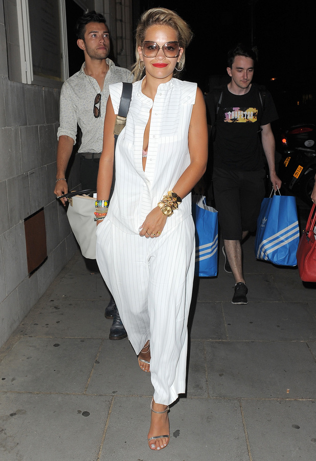Rita Ora leaves the Electric House in Notting Hill wearing a white jumpsuit, following a long night of drinking and socialising with friends. The group, including her stylist Kyle Devolle, left just before midnight, with one of Rita's assistants carrying two large bags of Adidas clothing