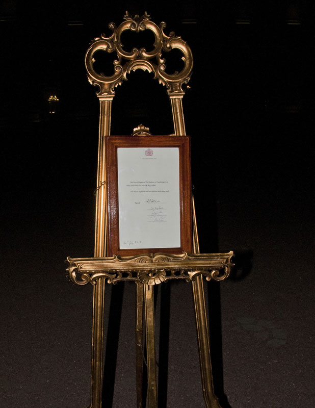 An easel stands in the Forecourt of Buckingham Palace to announce the birth of a baby boy, at 4:24 p.m. to the Duke and Duchess of Cambridge at St Mary's Hospital on July 22, 2013. The proclamation was mounted on a gold-trimmed wooden easel