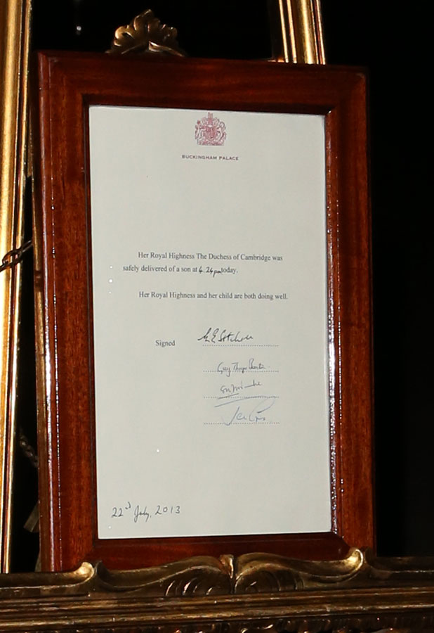An easel stands in the Forecourt of Buckingham Palace to announce the birth of a baby boy, at 4:24 p.m. to the Duke and Duchess of Cambridge at St Mary's Hospital on July 22, 2013. The proclamation was mounted on a gold-trimmed wooden ease