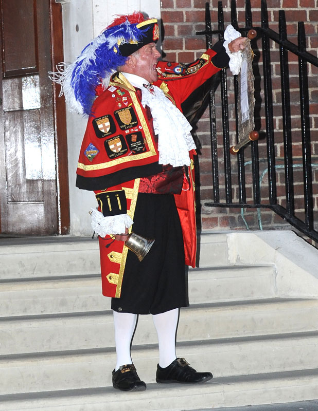 The town crier Tony Appleton announces the birth of the new royal baby outside St. Mary's Hospital. Prince William and his wife, Catherine, Duchess of Cambridge, had their first child, a boy, who becomes the third in line to the British throne