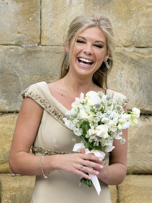 Chelsy Davy is bridesmaid at the wedding of Lady Melissa Percy to Thomas van Straubenzee in Northumberland, 22 June 2013