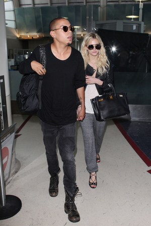 Evan Ross and Ashlee Simpson arrive together holding hands at LAX airport - 31 July 2013