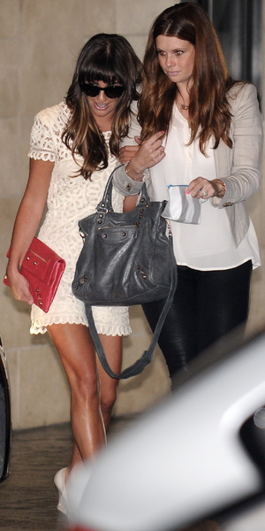 Lea Michele, wearing an off-white lace dress, departs the baby shower of Jamie-Lynn Sigler, August 3 2013