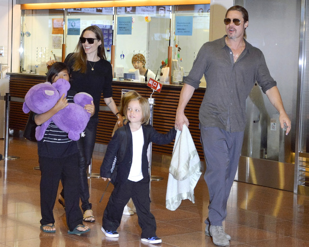 Angelina Jolie And Brad Pitt arrive at Narita International airport, Tokyo with their children Pax and twins Knox and Vivienne - 28 July 2013
