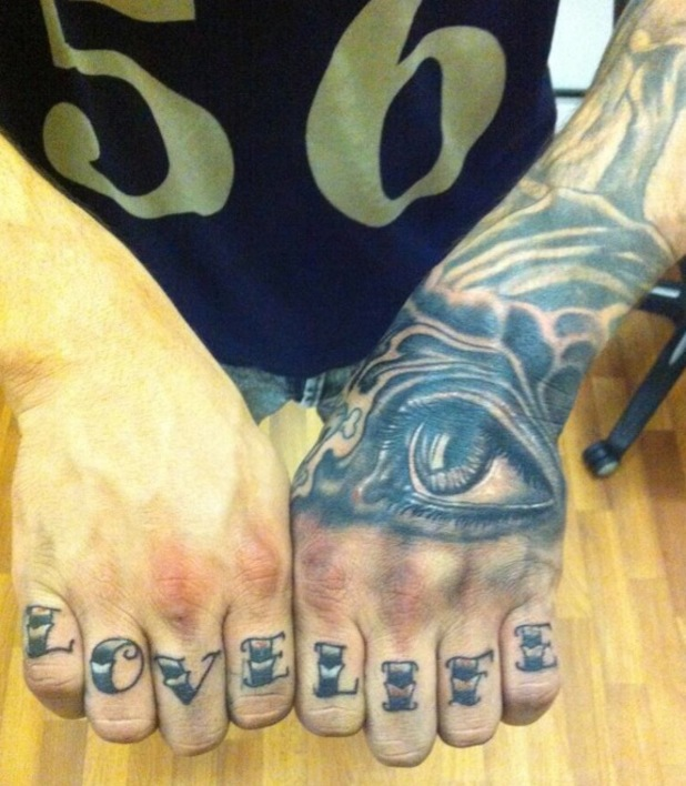 Kirk Norcross shows off his new tattoos, an eye and 'Love Life' - 30 July 2013
