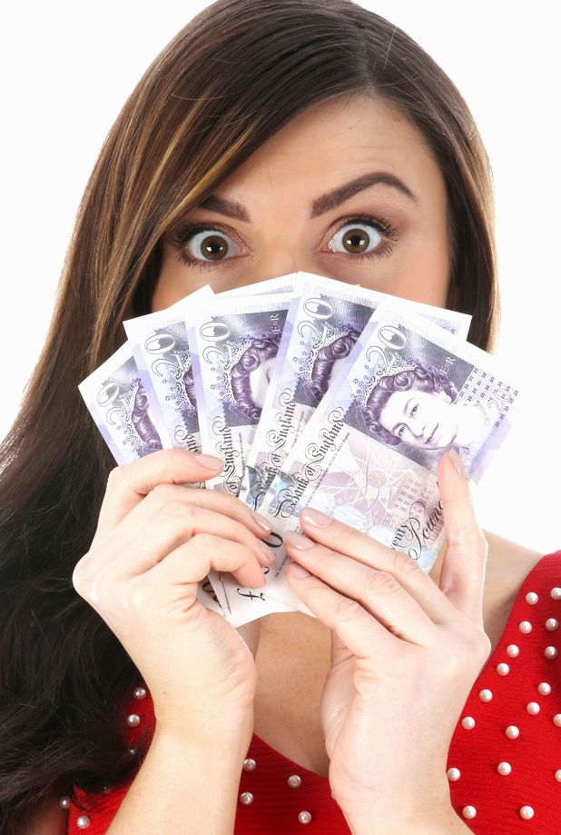 Young woman holding cash