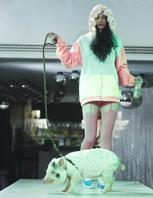 BINTM's Saffron Williams models in the competition with a pig - July 2013