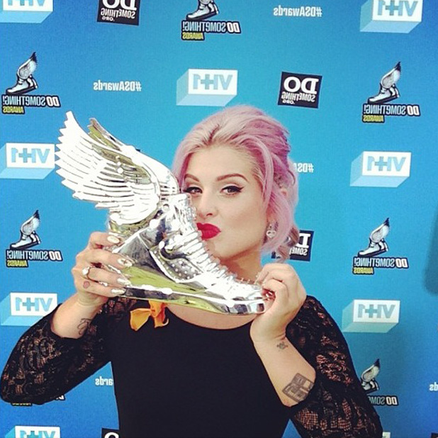 Kelly Osbourne with award at Do Something awards in Los Angeles