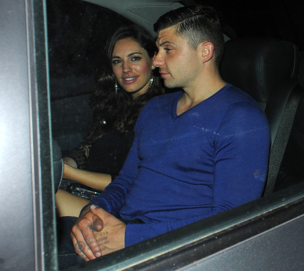 Kelly Brook puts her recent heartache behind her as she leaves Mayfair's Mahiki with a male friend, Aug 9