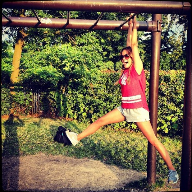 Caroline Flack goes swinging on monkey bars - 7 August 2013