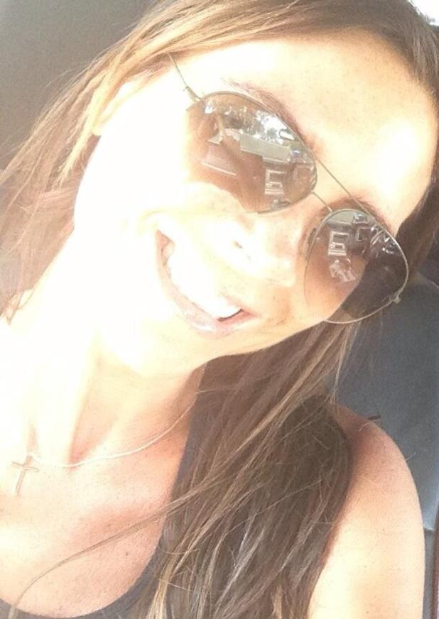 Victoria Beckham all smiles in the LA sunshine - 8 August 2013
