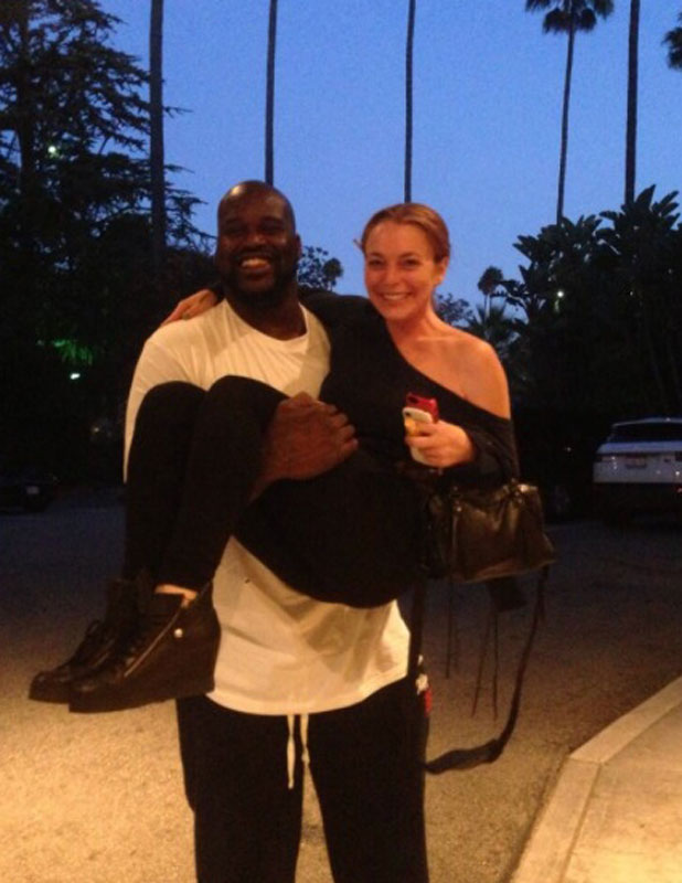 Lindsay Lohan is lifted up by Shaq in a Twitter picture dated 9 August 2013