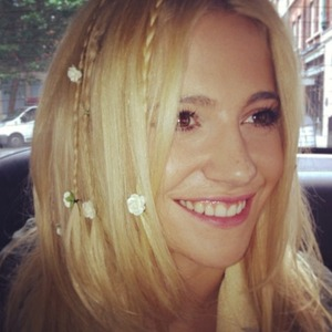 Pixie Lott's hairdresser, Holly Rudge Instagrams pictures of her plaited hair with flowers ahead of V Festival, 16 August 2013