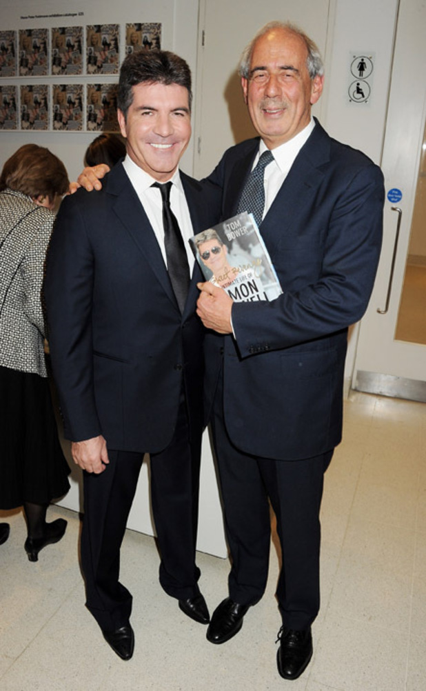 Simon Cowell and Tom Bower at the book launch of Sweet Revenge.