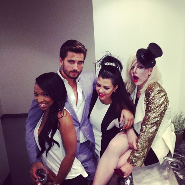 Kourtney Kardashian and Scott Disick pose at sister Kylie Jenner's 16th birthday party - August 17 2013