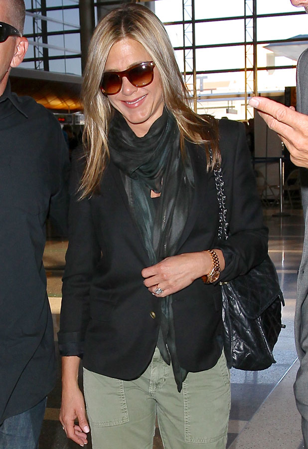 Jennifer Aniston catches a flight at Los Angeles International Airport (LAX), 12 August 2013