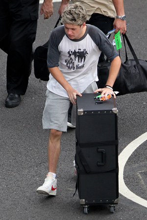 Niall Horan of  One Direction arrives at London Heathrow on a flight from Los Angeles after performing at the Teen Choice Awards PersonInImage:Niall Horan Credit :WENN.com