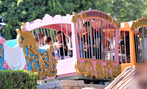 David and Victoria Beckham spend quality time with their kids at Disneyland. The famous family spent lots of time in Fantasyland, riding the Dumbo ride, a carousel and a children's train. Little Harper was spotted enjoying a carousel ride with her brothers and dad David, while mum Victoria, who was dressed down in casual jeans, looked on.