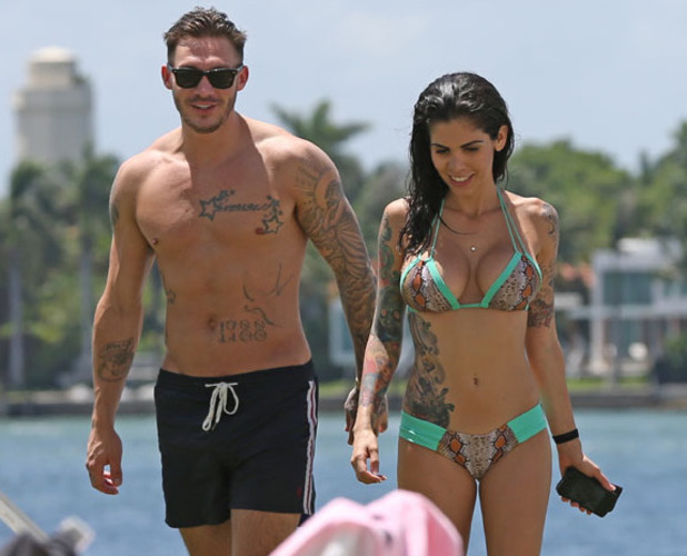 Kirk Norcross and Cami Li spend time poolside at their hotel in Miami. The couple spent some time at their hotel pool before heading to the airport to catch their flight to London. Model Cami looked fantastic in a snakeskin print bikini while shirtless Kirk showed off his toned body and numerous tattoos. The couple, who celebrated their engagement on Saturday night with Cami's friends and family, are heading back to the UK to start their new life together.