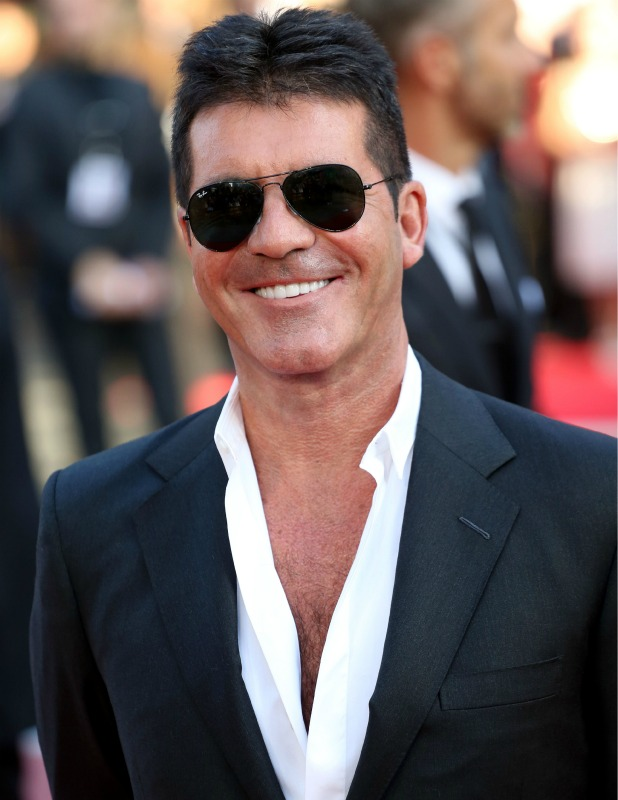 The 58-year old son of father Eric Cowell and mother Julie Cowell, 175 cm tall Simon Cowell in 2017 photo