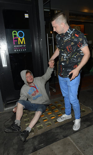 Plan B arriving at Groucho. Before he went in he handed £50 note to the homeless man sleeping on the street - 29 August 2013