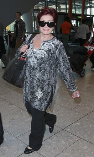 Sahron Osbourne arrives at Heathrow - 28.8.2013
