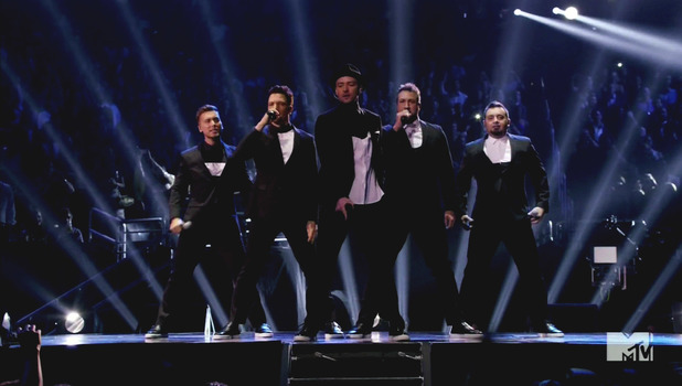 Justin Timberlake reunited with N'Sync (JC Chasez, Lance Bass, Joey Fatone, Chris Kirkpatrick) on stage at the 2013 MTV Video Music Awards held at the Barclays Center