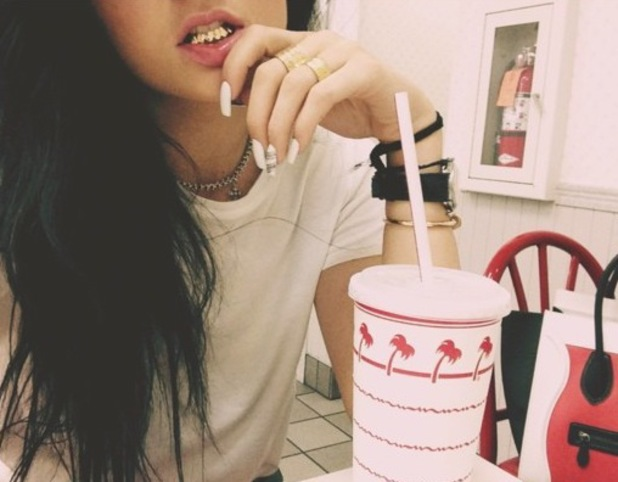 Kylie Jenner posts picture of herself wearing a grill - 3 September 2013