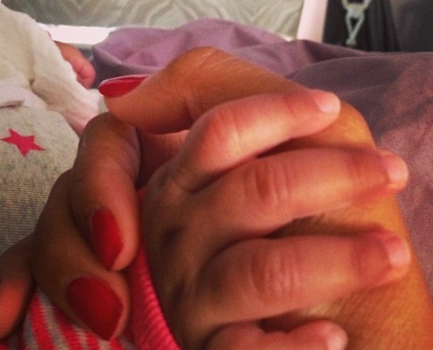 Rochelle Humes pictured holding daughter Alaia-Mai's hand in bed - 3 September 2013