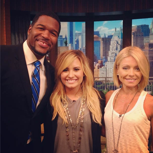 Demi Lovato with chat show hosts Kelly Ripa and Michael Strahan, on the set of Live with Kelly and Michael