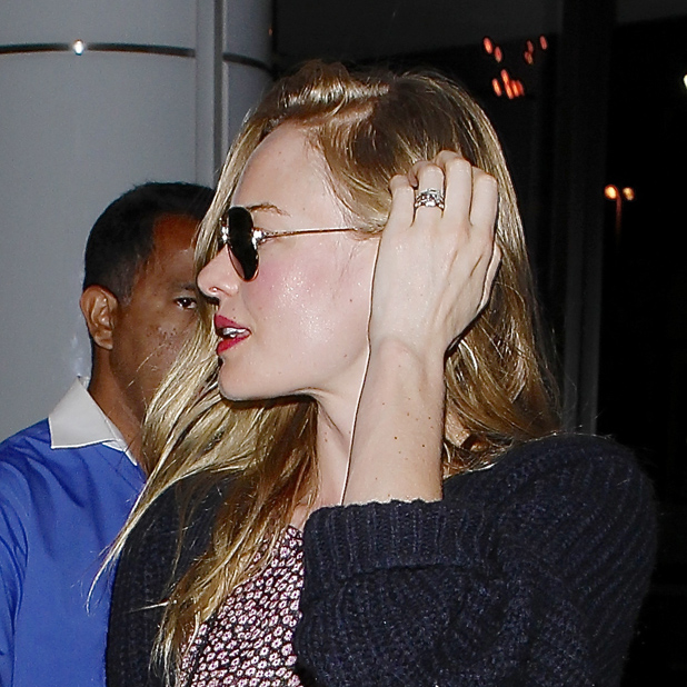 Newlyweds Kate Bosworth and Michael Polish arrive at LAX airport - close up of wedding band and engagement ring Credit :WENN.com Date Created : 09/03/2013 Location : Los Angeles, United States