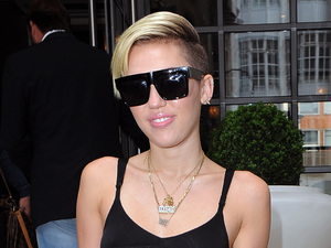 Miley Cyrus leaving her hotel in London on 11 September