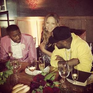 Mariah Carey in diamond sling at Nas' 40th birthday party.