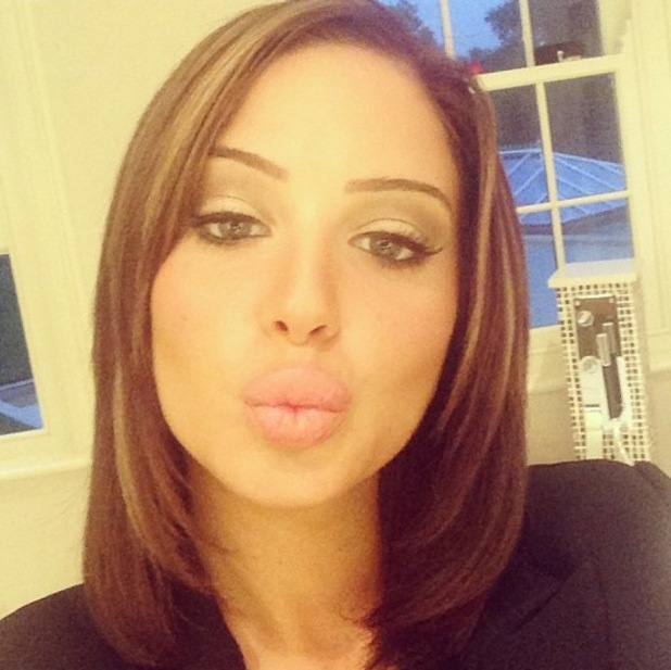 Tulisa shows off her short hairstyle - September 2013