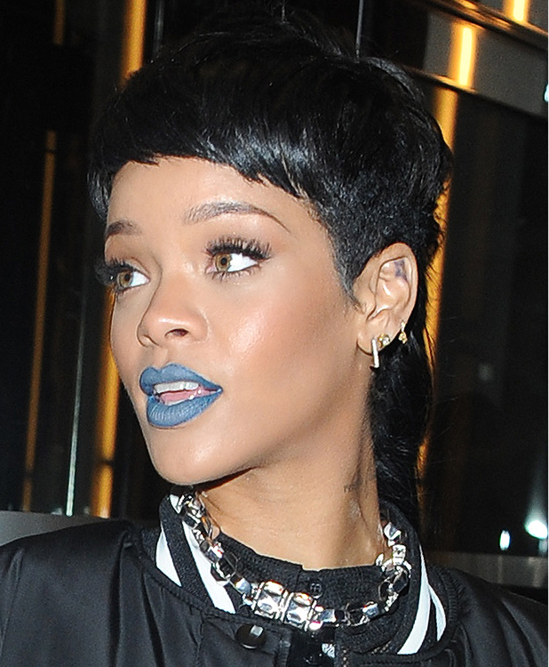 Rihanna Leaving 45 Park Lane Heading to River Island. Rihanna was seen wearing blue lipstick and a see through top as she left her hotel and headed to the launch. Credit :	Craig Harris/WENN.com