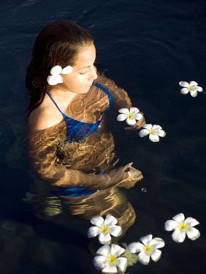 Model in a pool with flowers.