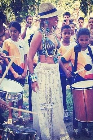 Beyonce uploads photos of her visiting communities, in between her tour (17 September)