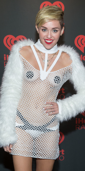 Miley Cyrus wears daring fishnet dress to iHeartRadio Music Festival at MGM Grand Garden Arena Las Vegas - Backstage