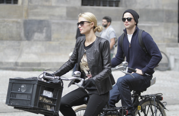 Paris Hilton pictured cycling around Amsterdam with her boyfriend River Viiperi. They visited the Pancake Bakery and also Dam Square. Sept 20 2013.