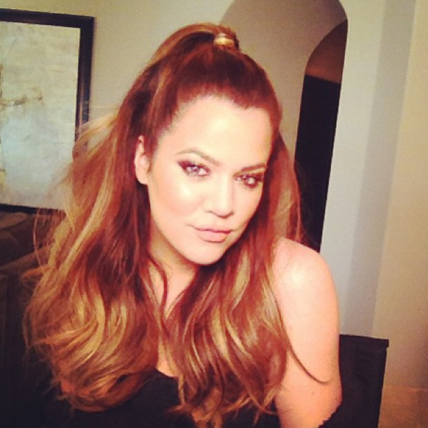 Khloe Kardashian Odom pictures herself with half hair up, hair hair down, 18 September 2013