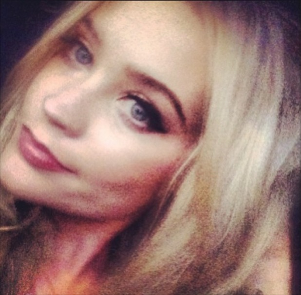 Laura Whitmore posts selfie on Instagram, drying hair in the back of a cab, 23 September 2013
