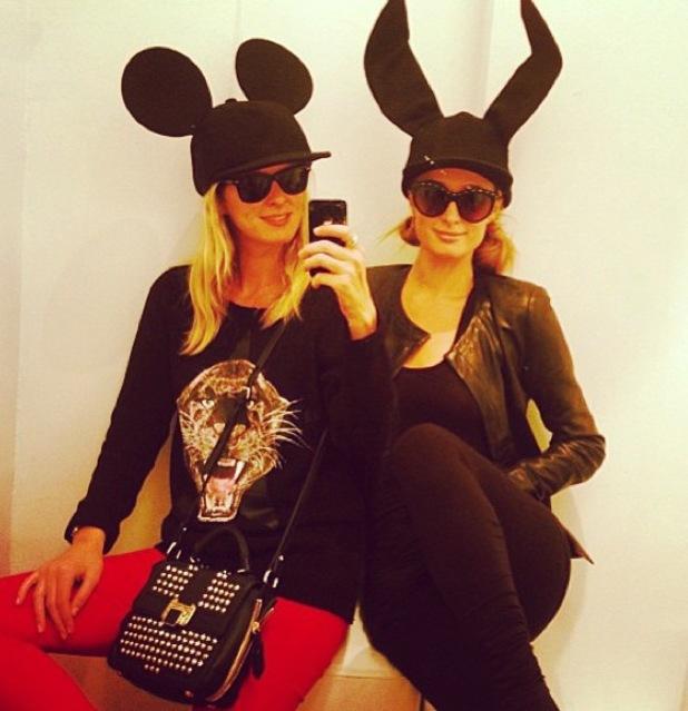Paris Hilton, Nicky Hilton try on Comme Des Garçons hats - 27.9.2013