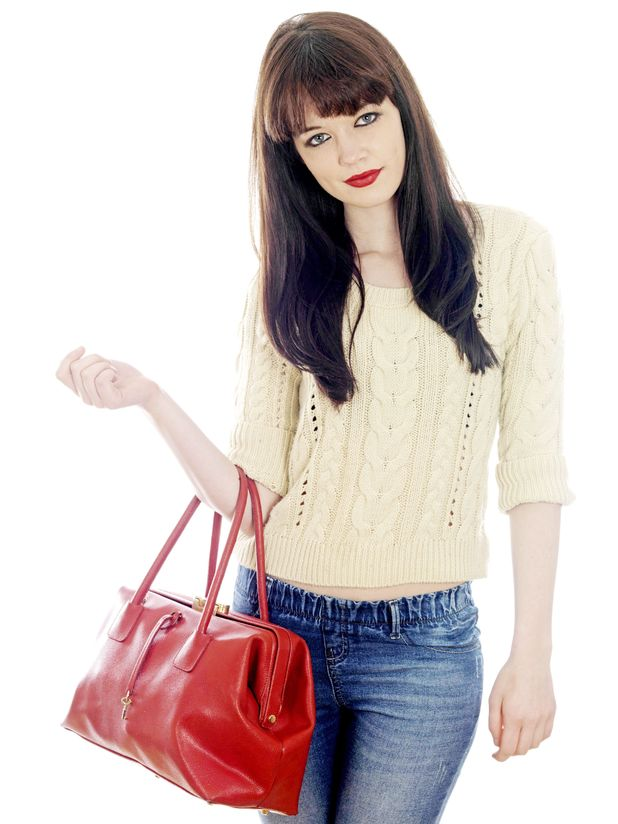 Model Released - Young Woman Holding a Red Handbag. 2011