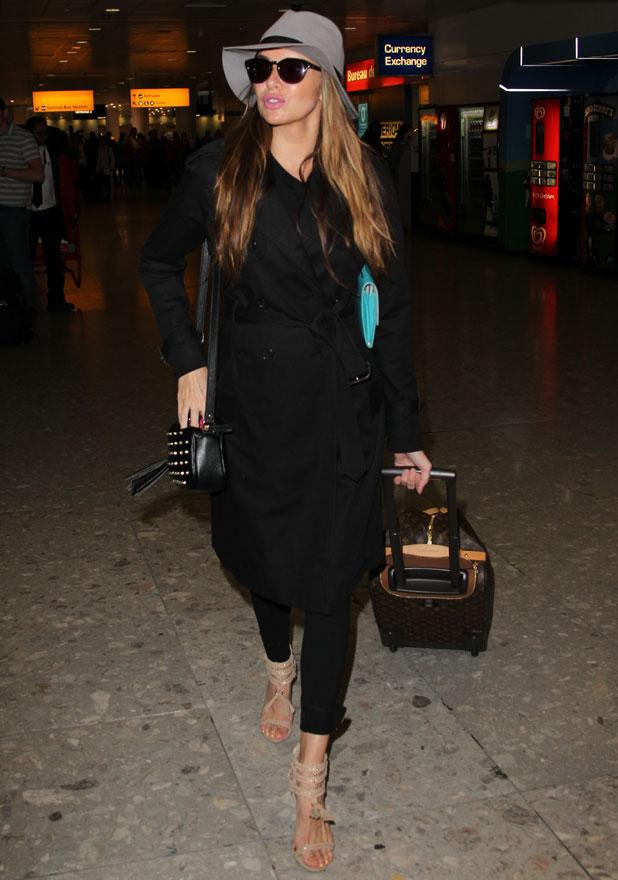 Pregnant Nadine Coyle arrives in London with her partner Jason Bell, 27 September 2013