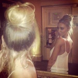 Lauren Pope poses wearing her Hair Rehab Messy Clip-in bun, 14 August 2013