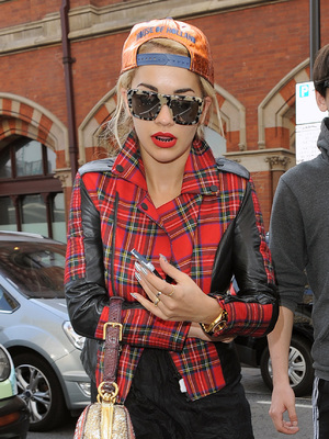 Rita Ora arrives at St Pancras Station on a Eurostar train from Paris. Rita beamed as she walked through the terminal, showing off her new black grills on her teeth. She was dressed all in tartan, with an orange baseball cap, 2 October 2013