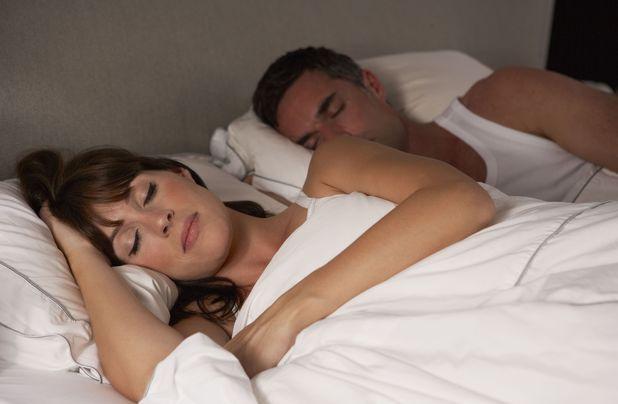 MODEL RELEASED Couple in bed asleep 2012