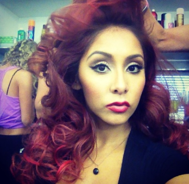 Snooki poses in hair and make-up before filming Dancing with the Stars, 30 September 2013
