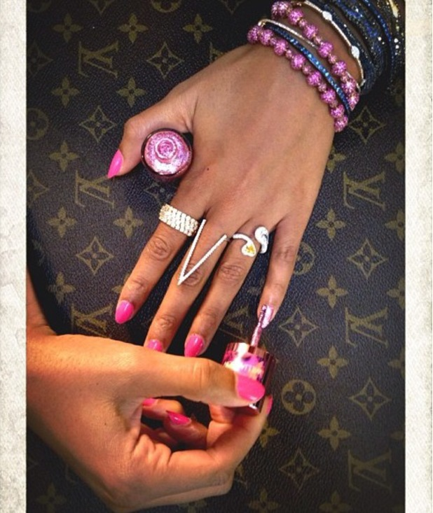 Beyoncé shows off her pink manicure as she paints her pinky pink with Nails Inc for Breast Cancer Awareness month, 1 October 2013