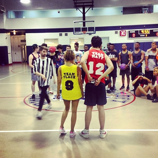 Caroline Flack and Matt Richardson play basketball with the groups in New York, 1 October 2013